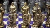 derrota : Golden chess pieces in the shape of ancient soldiers close-up. HD video