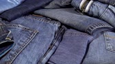 A pile of jeans clothes as a background. HD video Dostupné videozáznamy