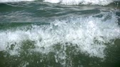 Slow motion of the sea wave with a foam and spray.
