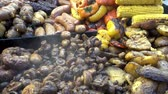 Food of street food stores. Mushrooms, corn, corn sausages and street stalls. HD video