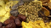 buda : Dried fruits and spices as a background. HD video