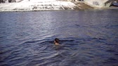 dnipro : Slow motion woman in winter. Feast of baptism. Kiev, Ukraine