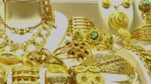 necklace : Piles of gold necklaces, chains and bracelets in oriental jewelry store. HD video Stock Footage
