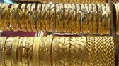 A lot of different gold bracelets in the showcase of a jewelry store. HD video
