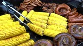 frankfurters : 4k view of street food. Grilled sausages. Stock Footage