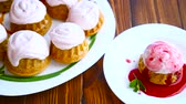 topped : sweet muffins with berry cream Stock Footage
