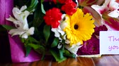 благодарность : beautiful bouquet of different flowers on a wooden table