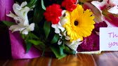 gerbera : beautiful bouquet of different flowers on a wooden table