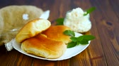 мята : fresh homemade sweet pies with cottage cheese on a wooden table