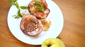 casserole : sweet ripe quince baked with walnuts and honey on a wooden table