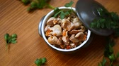chicken recipe : stewed chicken stomachs on a wooden table