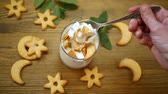 drinking milk : sweet homemade yogurt with cookies Stock Footage