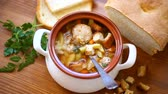 parcela : vegetable soup with beans and meatballs in a ceramic bowl