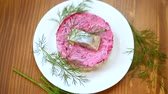 layered salad of boiled vegetables with beets and herring Stock Footage