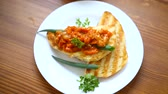 pimenta : fried bread toasts with stewed beans and vegetables in a plate