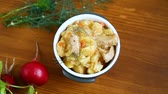 potato casseroles : stewed potatoes with vegetables, cabbage and meat in a bowl