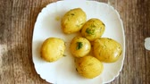 potato dishes : boiled young potato with butter and dill in a plate Stock Footage