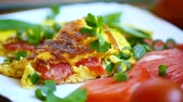 apoyarse : fried omelet from homemade organic eggs with tomatoes and green onions