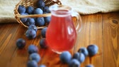 licorera : sweet compote of autumn blue plums in a glass decanter