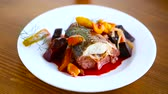 spieß : fish stew with beets and other vegetables in a plate