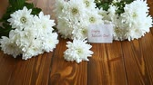 krizantem : bouquet of white chrysanthemums on wooden table