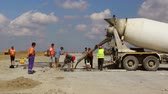 mix : TULCEA, ROMANIA - SEPTEMBER 26: Cement truck pouring cement into a runway construction as part of the Danube Delta international airport expansion plan time lapse on September 26,2015 in Tulcea, Romania. Stock Footage