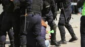 riot control : TULCEA, ROMANIA - APRIL 28: Gendarmes detaining a protester during a riot-control exercise on April 28, 2017 in Tulcea, Romania