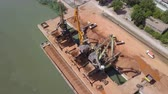 bauxite : TulceaRomania - May 23, 2018: Industrial cargo port with operating cranes on the Danube river, aerial view