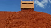 bauxite : Dumper truck unloading ore for manufacturing plant