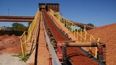 сырье : Conveyor belt transporting ore to the manufacturing plant