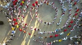 Словакия : TULCEA, ROMANIA - AUGUST 08: Friendship dance (aerial view) at the International Folklore Festival for Children and Youth - Golden Fish on August 08, 2018 in Tulcea, Romania. Стоковые видеозаписи