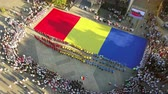Словакия : TULCEA, ROMANIA - AUGUST 08: Opening ceremony (aerial view) of the International Folklore Festival for Children and Youth - Golden Fish on August 08, 2018 in Tulcea, Romania. Стоковые видеозаписи