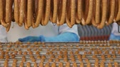 guloseimas : Fresh sausages are placed on racks in a meat processing factory