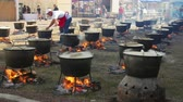 Jurilovca, Romania - 02 September 2019: Fish soup festival. Chefs cooking fish broth, outdoors in kettles. Stock Footage