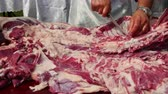 Farmer butchering a whole lamb, cutting lamb ribs and drying the meat
