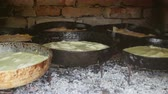 Different types of pie baking in a wood-fired brick oven