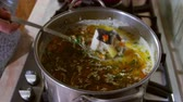 agrio : Housewife cooking storceag, a fish soup with sour cream and egg, soured with lemon juice. Storceag is a traditional fish soup in the Danube Delta.