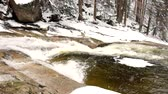 bubble : Frozen snow on boulders in clear cold water of mountain river. Crystal chilly water of noisy stream. Stock Footage