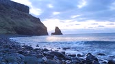 maritime territory : Evening in Talisker bay on west coast of the Isle of Skye in Scotland during an windy sunset. Sharp rocky tower above the foamy sea of ??the Hebrides, waves crashing against a rock boulders and sharp