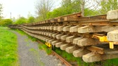 предъявитель : Used sleepers stock on wagon in depot. Old, dirty and rusty Used concrete and wooden railway ties Stored after reconstruction of railway station. Rails will transport a steel foundry for recycling Стоковые видеозаписи