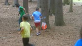 Runner pass orienteering checkpoint in a forest. Running sport trail with navigation.