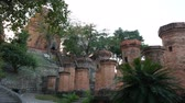 остатки : Brick columns at the Po Nagar Cham Towers in Nha Trang, Vietnam. Panning from temple to columns. Стоковые видеозаписи