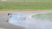 andarilho : Slow motion of a gray car drifting u-turn during a race Stock Footage