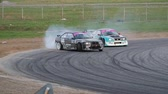 andarilho : Two racing cars making an u-turn with a drift on a race track Stock Footage