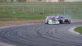 andarilho : Racing cars bumping and trying to leave behinde each other at the u-turn Stock Footage