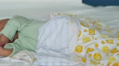 roupa de dormir : Sweet dream of a newborn child. Panning to the face Stock Footage