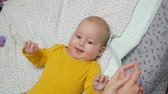 драгоценный : Joyful baby boy laughing while young woman playing with him. Handheld shot Стоковые видеозаписи
