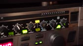 dallam : Tuning controls on a sound equipment. Handheld shot