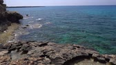 основной момент : Panning view of a beautiful rough rocky coastline of Mediterranean Sea