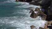 enseada : Rocky bay in Mediterranean Sea. Waves crash on coastal stones